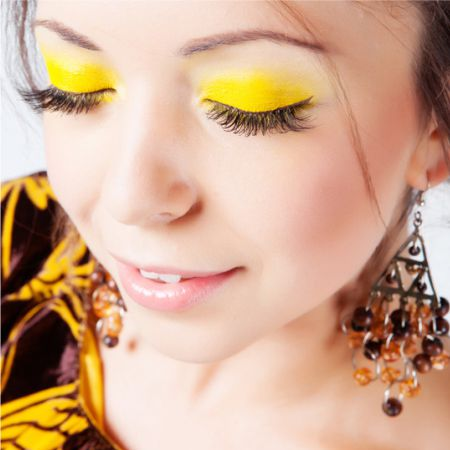 Eye makeup in yellow colors